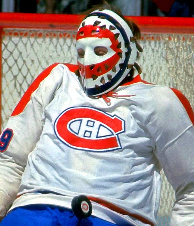 By 1970, there were goalie masks of all types, but the one thing they had in common was their color, or lack thereof. Most masks were painted white, and nothing else. That is, until Boston's Gerry Cheevers unknowingly began the trend of decorating/personalizing the mask with just a few strokes of a black marker. What soon followed were different colored paints and graphics, which transformed masks from plain pieces of protective equipment to colorful works of art. Here we rank the top 10 masks of the first expansion era (1967-82), beginning with Ken Dryden's. In 1976, Dryden debuted a new mask with a red circle in the shape of the Canadiens' logo inside a larger blue one. On a white background, the circles provided a target effect, inviting shooters to aim for the bull's-eye.