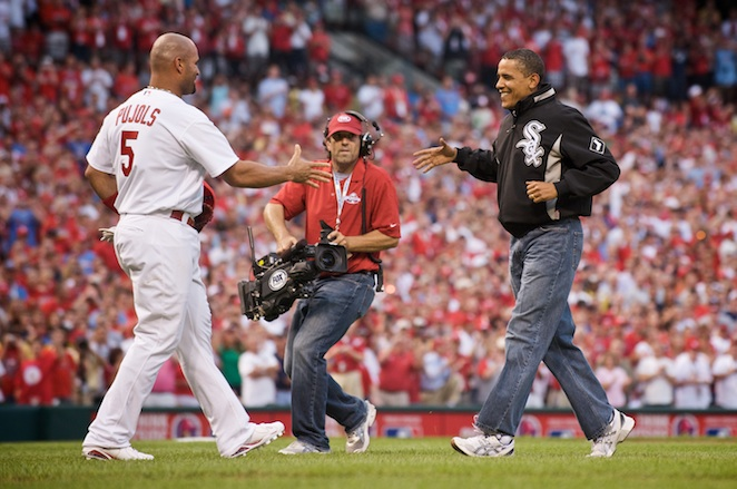 Albert Pujols delivers the ball back to the President after his ceremonial toss.