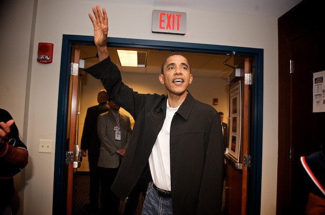 President Obama wishes the American League team luck on his way out of the clubhouse.