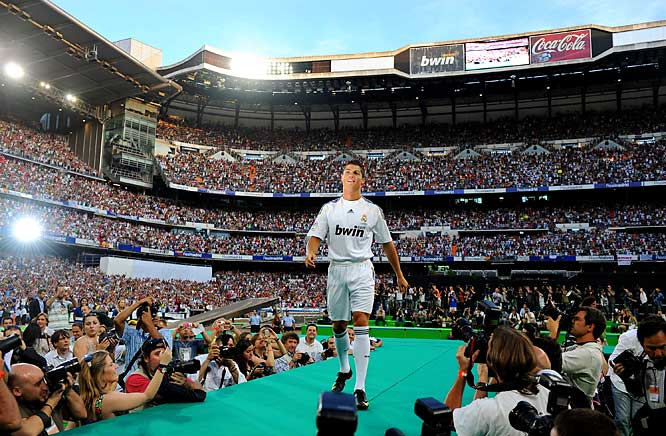 If you thought Ronaldo's record transfer fee was crazy ($130 million), that was nothing compared to the scene where more than 80,000 fans packed the team's stadium to welcome the new Real Madrid star, who simply trotted on stage in his new uniform as if he were at a fashion show.
