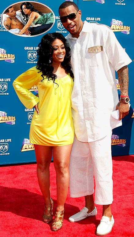 It seems that athletes can't get enough of celebrities. The latest couple to grace the pages of a magazine for a gratuitous photo spread are Kenyon Martin and his rapper girlfriend, Trina, who used to date Lil' Wayne. We didn't agree with Mark Cuban before, but we'd be all for heckling Martin at this point after looking at those airbrushed photos.