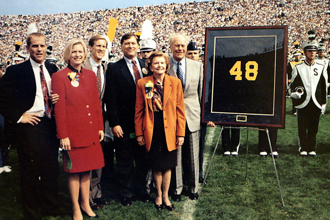 Gerald Ford and family pose during his jersey retirement ceremony in Ann Arbor, Mich. Ford, who played center and linebacker, helped the Wolverines to undefeated seasons and national titles in 1932 and 1933.