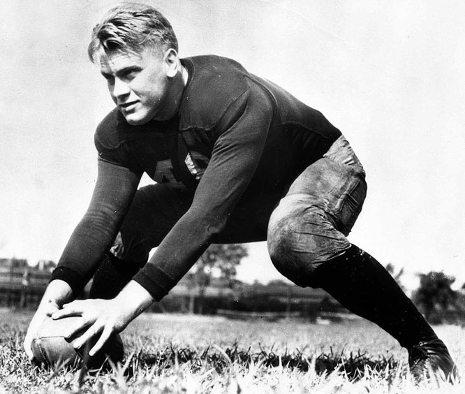 Gerald Ford in action while a star center at  Michigan in 1934.