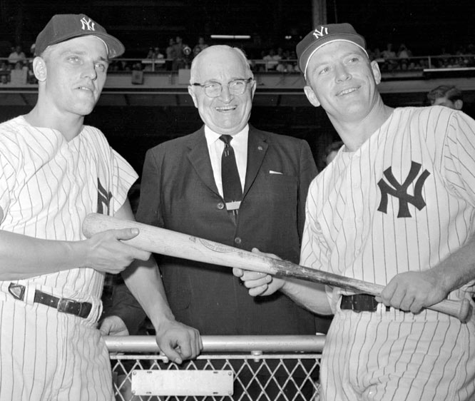 Harry Truman is flanked by Yankees Roger Maris (left) and Mickey Mantle before a game against the Senators at Yankee Stadium.