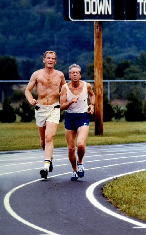 Jimmy Carter jogs with a Secret Service agent at the Prairie Du Chien High football field in Wisconsin.