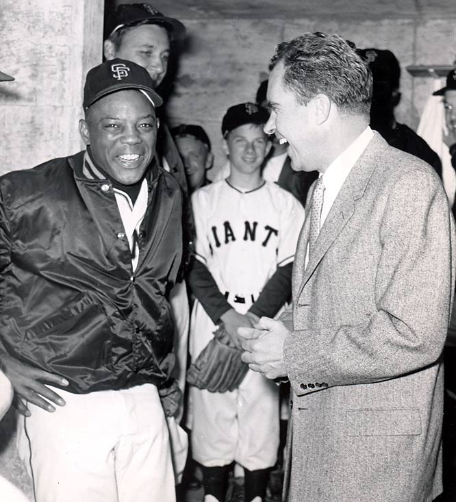 San Francisco Giants outfielder Wille Mays speaks with Richard Nixon in the dugout prior to a Cardinals-Giants game at Candlestick Park.
