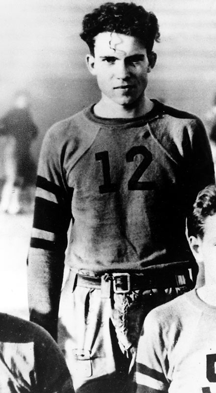 In this photo, a young Richard Nixon dons his football attire while playing pigskin at Whittier College. Nixon also played basketball and ran track while a college student.