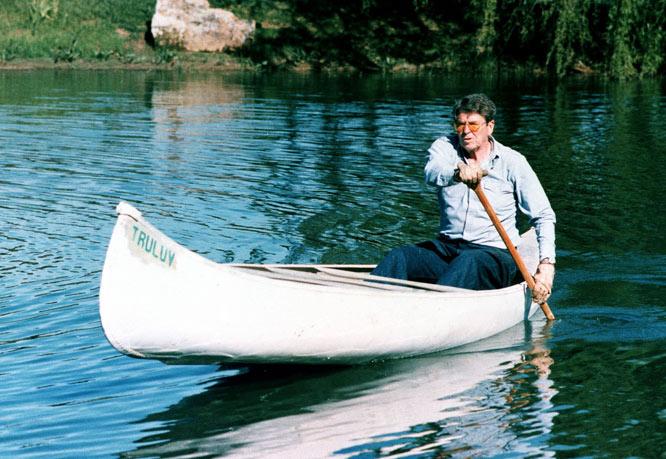 Ronald Reagan paddles a canoe while at his ranch near Santa Barbara, Calif.