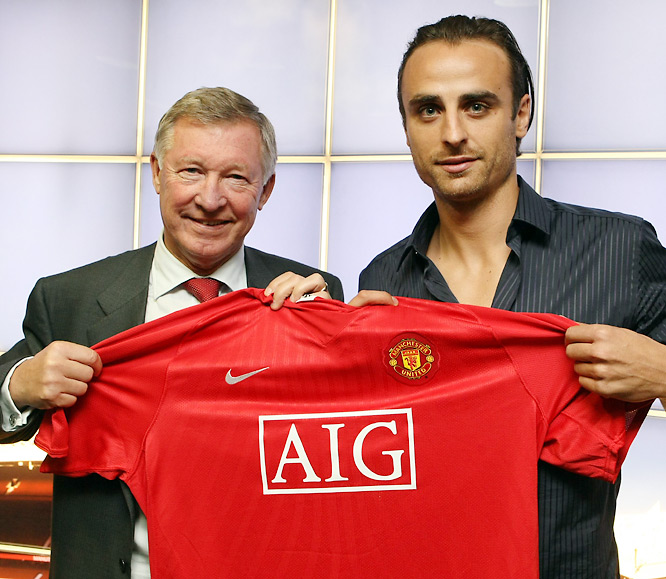 The Bulgarian striker had emerged as a star for Tottenham Hotspur, and made no bones about his desire to play for a bigger club. As rumors of Manchester United's interest increased, so did Berbatov's unrest and moodiness. Finally, as the transfer window was coming to a close, Sir Alex Ferguson (left) made his move and brought the high-scoring forward to Old Trafford.