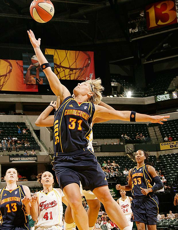 Seems like every time the Sun adds another player, they pick up another win. Last week Erin Phillips (pictured) & Co. were aided by Sandrine Gruda, a French forward-center who had been away from the squad while representing her country in the European championships. Coach Mike Thibault, who drafted Gruda 13th overall in '07, was willing to wait a month until she finished her overseas commitment, and boy was she worth the wait. Last Sunday, she scored 23 points to help Connecticut to a 95-92 overtime victory over Detroit.<br><br>Next three: 7/11 vs. Detroit; 7/14 vs. Los Angeles; 7/14 at San Antonio