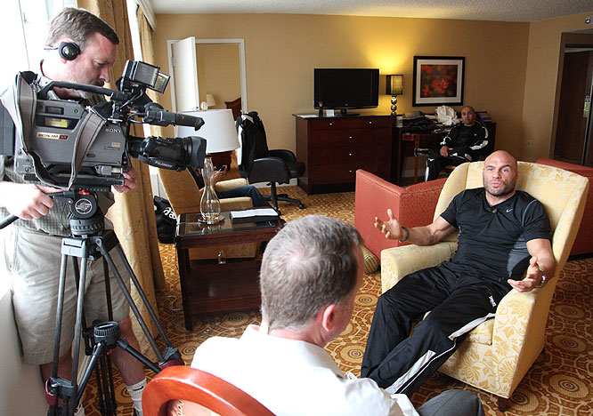 Randy Couture, in hot media demand Friday, gives an interview with a television station.