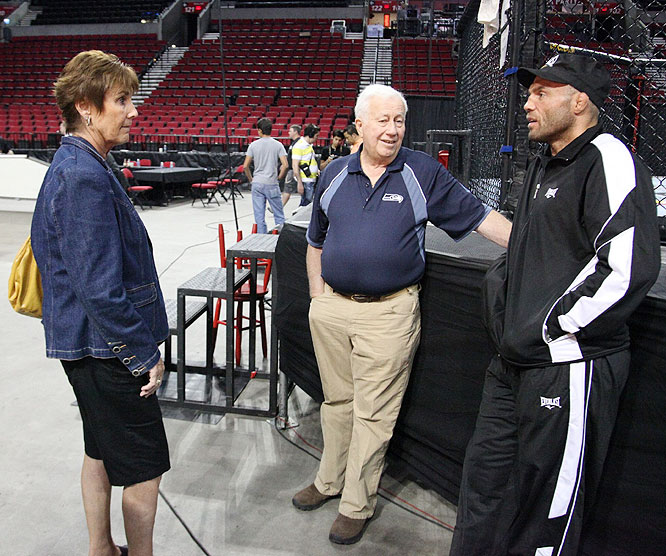Randy Couture chats with his parents Friday while standing beside the cage at Portland's Rose Garden.