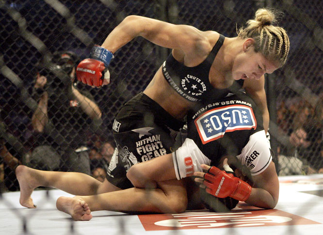 It was a back-and-forth clash until Cyborg found herself on top of Carano, pummeling her with lefts and rights.