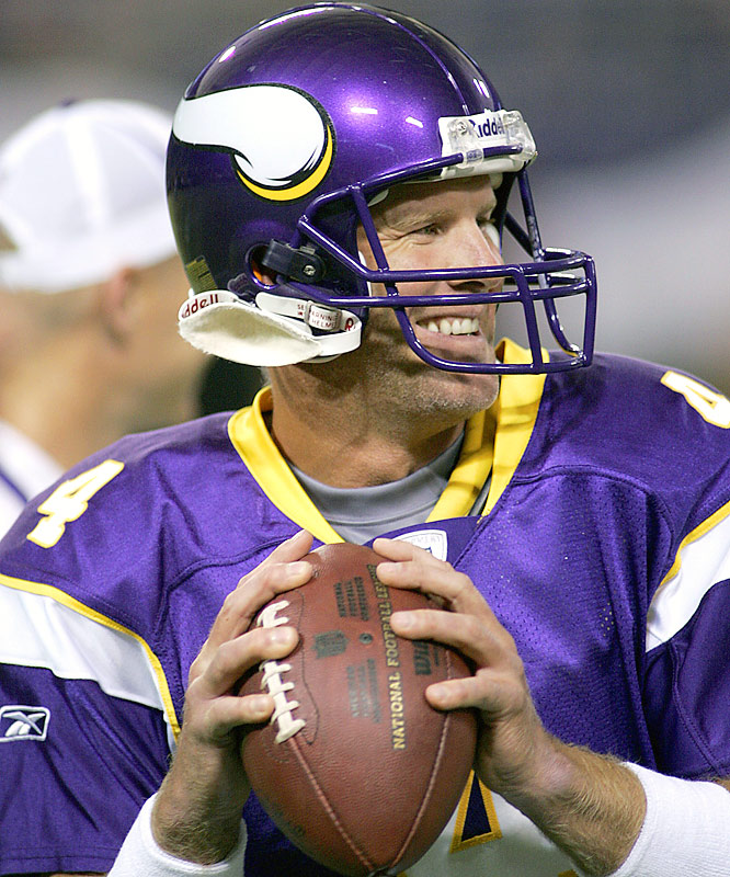 Brett Favre squeezes in a smile while warming up to face the Chiefs.