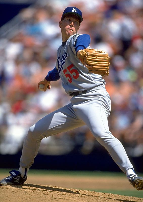 Orel Hershiser gets ready to deliver during a game against the Cardinals.
