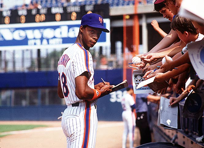 Darryl Strawberry signs autographs for fans at Shea Stadium. He was named the National League's 1984 Rookie of The Year after hitting 26 home runs with 97 RBIs.