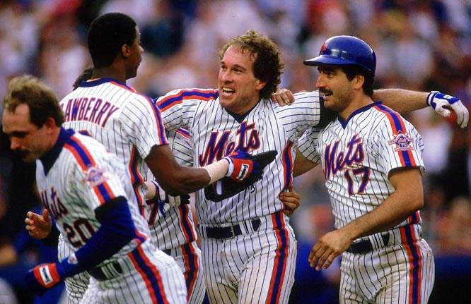 Gary Carter celebrates with Darryl Strawberry and Keith Hernandez after the Mets catcher's game-winning hit against Philadelphia.
