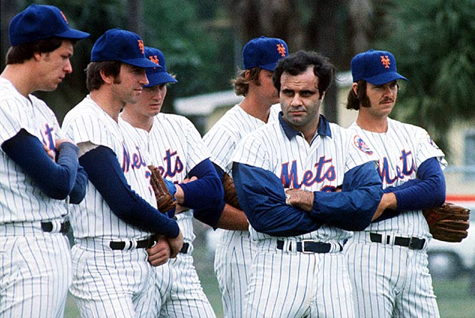 Joe Torre stands with teammates during spring training in 1975. Torre was the team's third baseman when he was asked to take over as manager. He spent 18 days as a player-manager before hanging up his cleats.