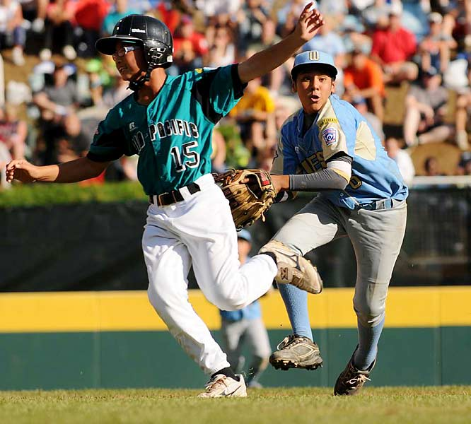 California escaped Taiwan's bases-loaded threat in the fifth inning after shortstop Andy Rios (right) tagged out a runner, then threw to first to complete a double play.