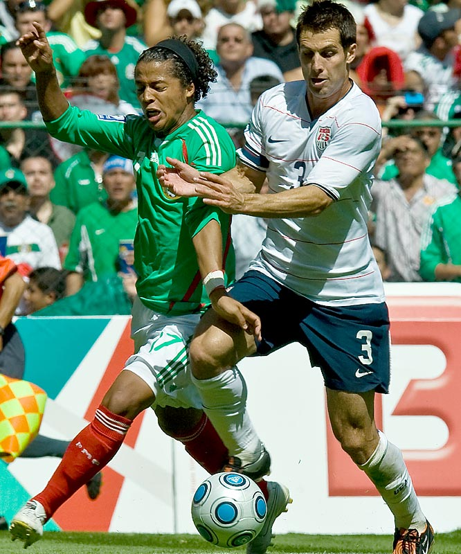 The United States' Carlos Bocanegra (right) has the inside track on this loose ball as he battles Mexico's Giovanni dos Santos for possession.
