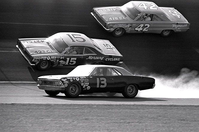 How cool were the NASCAR vehicles of the 1960s. Here, in Feb. 1967, Curtis Turner's 1966 Chevrolet (13)  goes off the track at the Daytona International Speedway after his engine blew up in the 143rd lap. Also shown are Sam McQuagg (15) of Columbus, Ga., driving a 1967 Mercury, and Tiny Lund (42), driving a 1966 Plymouth.
