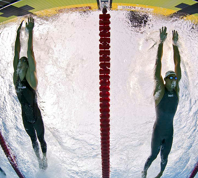 Like their race in Beijing, the 100 butterfly was decided on the final stroke, with Phelps winning this time by .13.