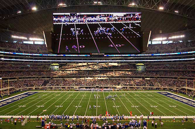 "So Cowboys owner Jerry Jones spends $1.15 billion on a new stadium with the world's largest HD television screen, but somehow forgets to make sure it isn't hanging too low over the field. Well, it is, as Titans punter A.J. Trapasso proved when he booted a ball that hit the bottom of the JumboTron during the first game at the stadium. More embarrassing than the structural gaffe was Jones' blaming Trapasso for punting the ball ""straight up."" Yes, Jerry, that's where punts go in football, ""straight up."""