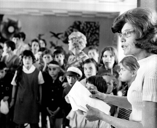 In this photo, Kennedy Shriver speaks to a group of mentally handicapped children in Paris 1969.  Shriver was on a trip to Europe preparing children for the 1970 Special Olympics.