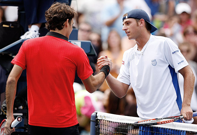 Roger Federer (left) shakes hands with Devin Britton of the U.S. after defeating him during day one of the 2009 U.S. Open.