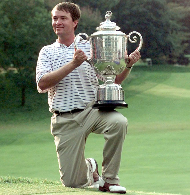 At the 79th PGA Championship, Davis Love III shoots a 269 to capture the title.
