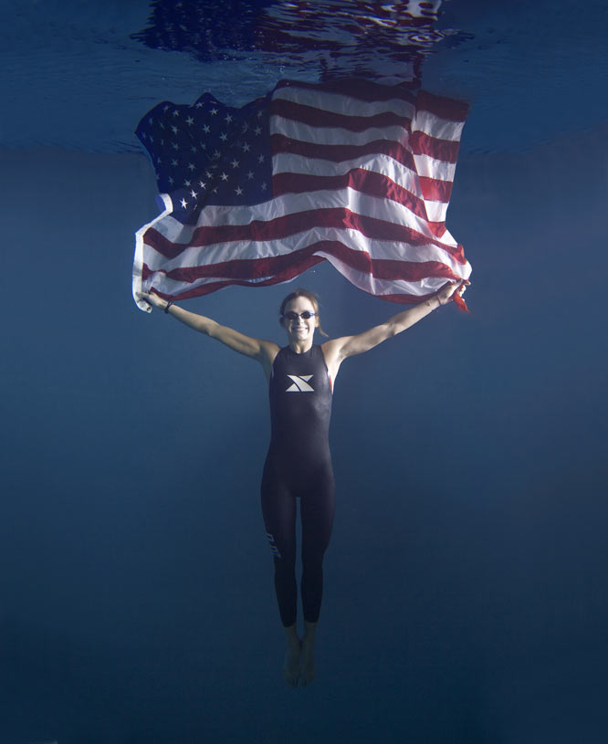 I was asked to create an image to illustrate that triathlete Linsey Corbin was the top American finisher in The Ironman World Championship. We shot the image at a sporting goods store that had an underwater viewing window that allowed customers to watch people in their pool during scuba lessons. Using radio triggers, I fired strobe lights through windows in the parking lot while I shot from inside the store and never got wet!