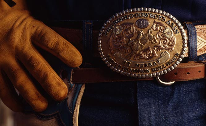 If you can stay on enough bulls for 8 seconds, they will give you one of these buckles!
