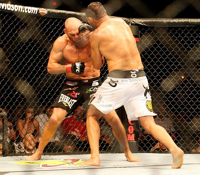 The 46-year-old Couture (black trunks) was knocked down twice by Nogueira and barely escaped multiple submission attempts.