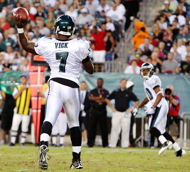 Michael Vick completed all four of his attempts, including this screen pass to DeSean Jackson.