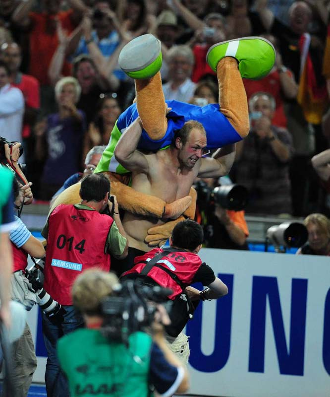 Harting was so excited over winning the discus that he celebrated with the world championship's mascot, Berlino.