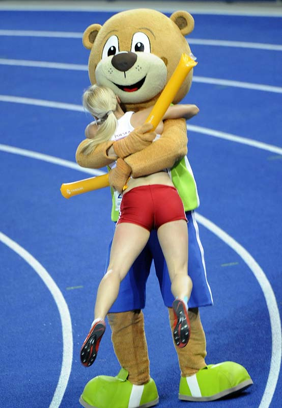 Poland's Anna Rogowska celebrates her victory in the women's pole vault final with the mascot Berlino.