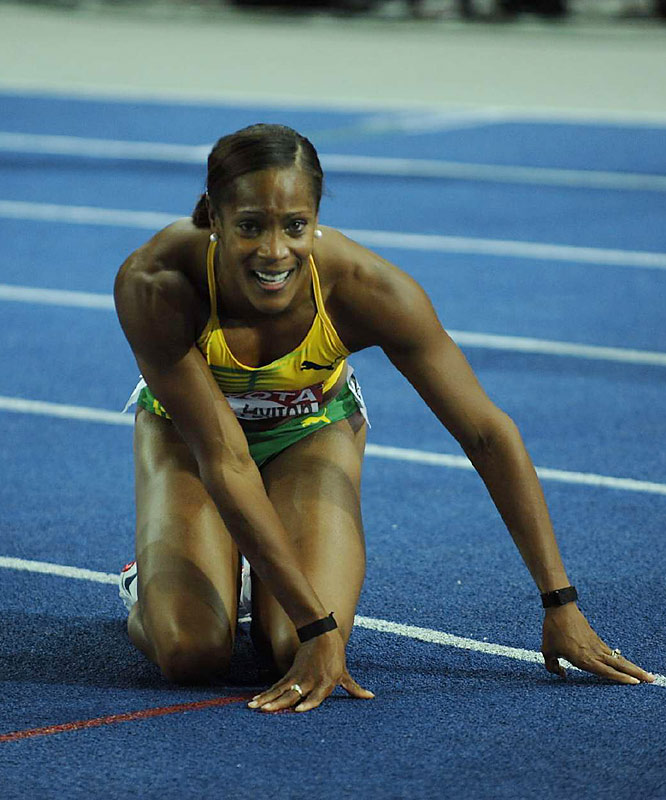 Brigitte Foster-Hylton is overcome after giving Jamaica its first world championships gold medal ever in the 100m hurdles.