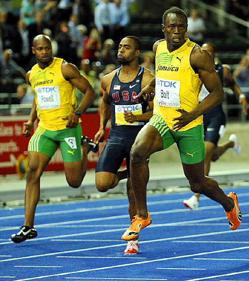 Unlike in the Olympics, when he began celebrating about 10 meters before the finish, Bolt finished strong this time, with Tyson Gay (center) taking second and Asafa Powell (far left) third.