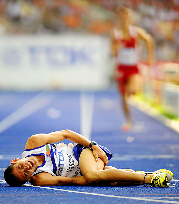 Alvaro Vasquez of Nicaragua fell to the track in pain after pulling up in a heat of the 1,500 meters.
