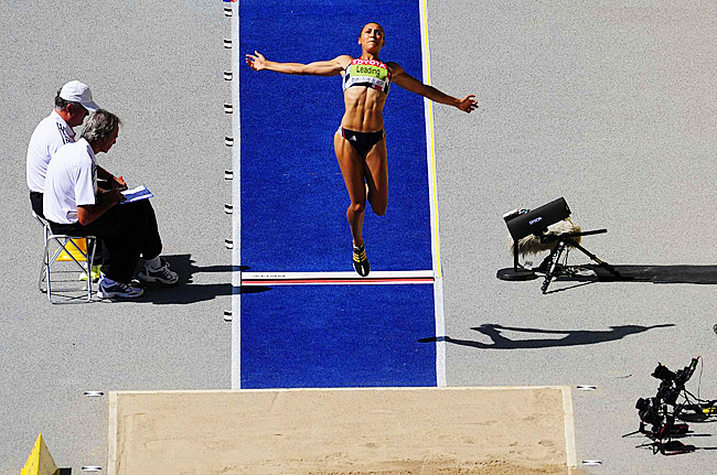 Jessica Ennis of Great Britain straining for every inch in the long jump portion of the heptathlon.