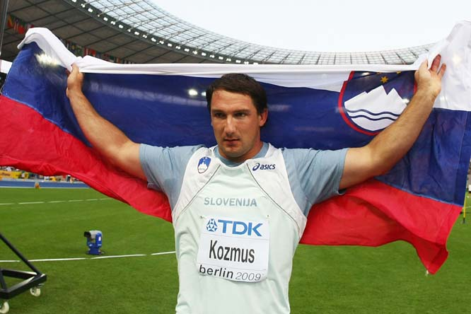Primo Kozmus of Slovenia celebrates winning the gold medal in the men's hammer throw final.