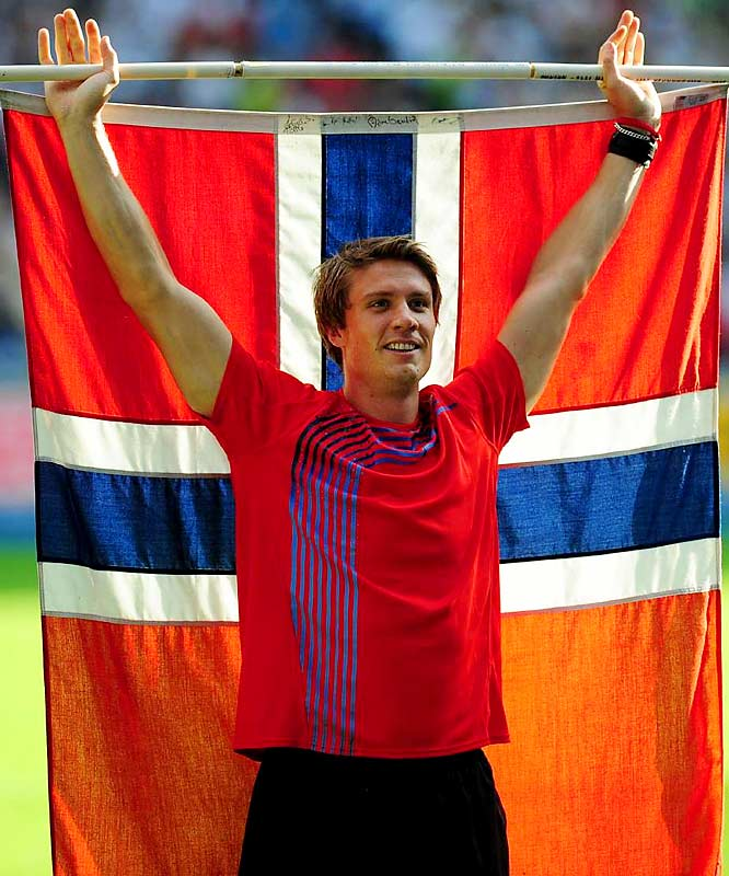 Norway's Andreas Thorkildsen proudly displays his national colors after claiming gold in the javelin.