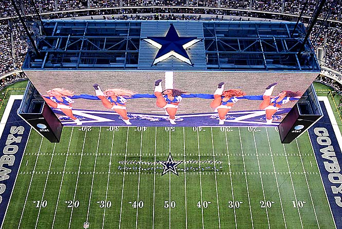 What would the Cowboys be without their cheerleaders, displayed here on the new video board that stretches from the 20 to the 20.