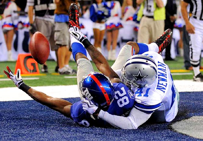 Mario Manningham made a circus catch against Terence Newman to ruin the Cowboys stadium opener.