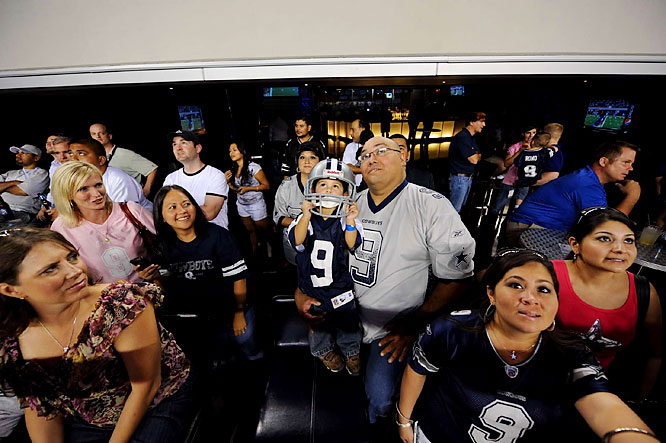 Tony Romo fans watching their hero play the opening regular season game in the new stadium.
