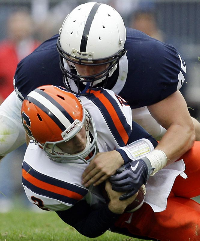 Sean Lee (top) and the Nittany Lions overwhelmed Greg Paulus and the Orange, limiting them to 200 total yards.