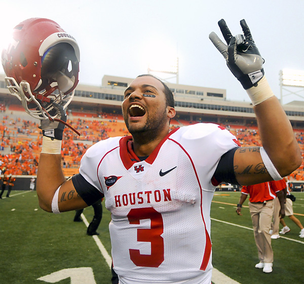 Justin Johnson and the Cougars are riding high from Houston's stunning win over OSU at new Boone Pickens Stadium. UH amassed 512 yards and scored 21 fourth-quarter points to secure the upset.