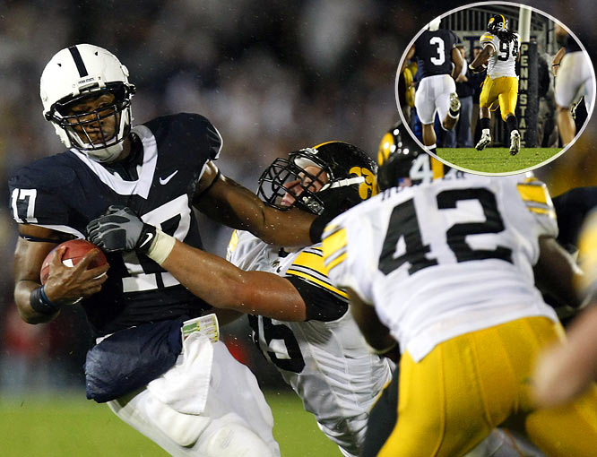 The Hawkeyes pressured All-Big Ten quarterback Daryll Clark into a nightmarish 11-of-31, 183-yard, three-interception performance and Adrian Clayborn (inset) returned a blocked punt for a touchdown as Iowa slugged out an ugly win in soggy Happy Valley to upset Penn State for the second straight year.