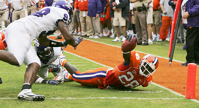 TCU's Tejay Johnson and Jerry Hughes stopped CJ Spiller on this first-half play and helped hold the Tigers scoreless in the second half in the Horned Frogs statement win in Clemson, S.C.
