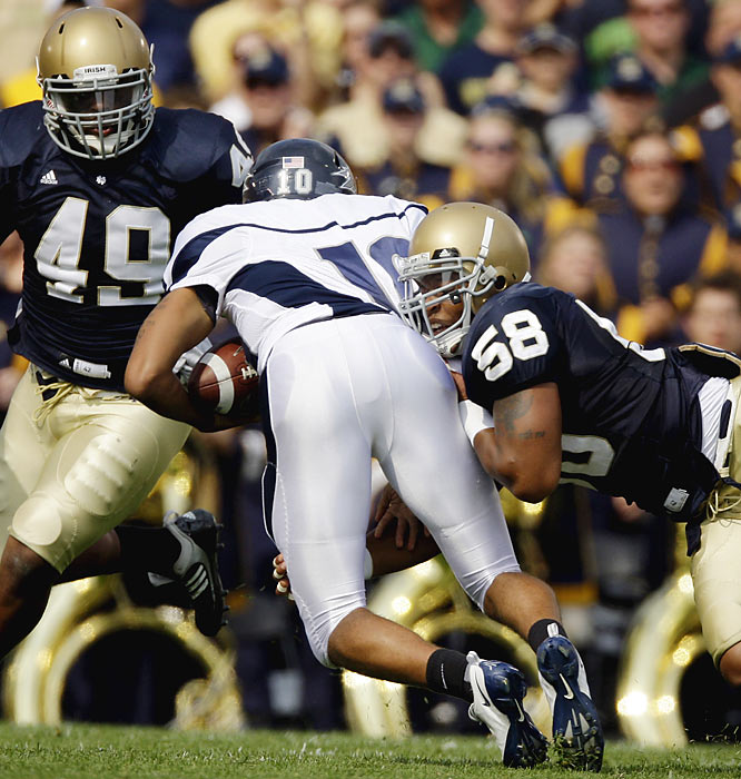 Notre Dame's Brian Smith (right) and Toryan Smith combine for one of two sacks of Nevada's Colin Kaepernick. The Irish defense held the Wolf Pack to 154 passing yards.